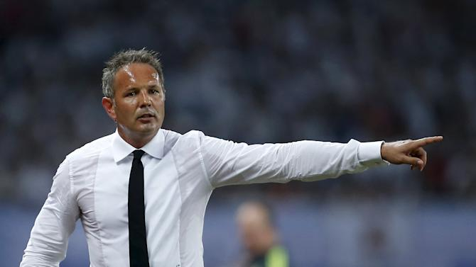 A.C. Milan coach Mihajlovic reacts during the International Champions Cup soccer match against Real Madrid in Shanghai