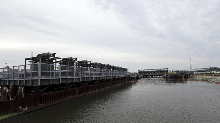 The new pumping station at the 17th Street Canal levee is shown Monday, Aug. 27, 2012, in New Orleans. A portion of the levee broke seven years ago when Hurricane Katrina hit. Tropical Storm Isaac is churning it's way across the Gulf of Mexico and could make landfall near New Orleans later this week. (AP Photo/David J. Phillip)