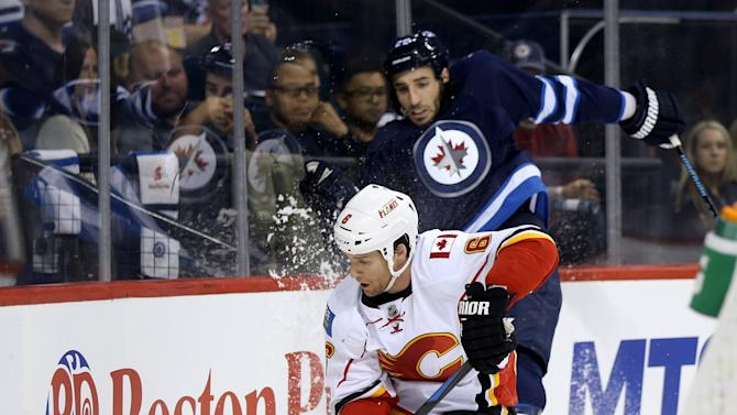Raymond has 3 points to lead Flames past Jets 4-1