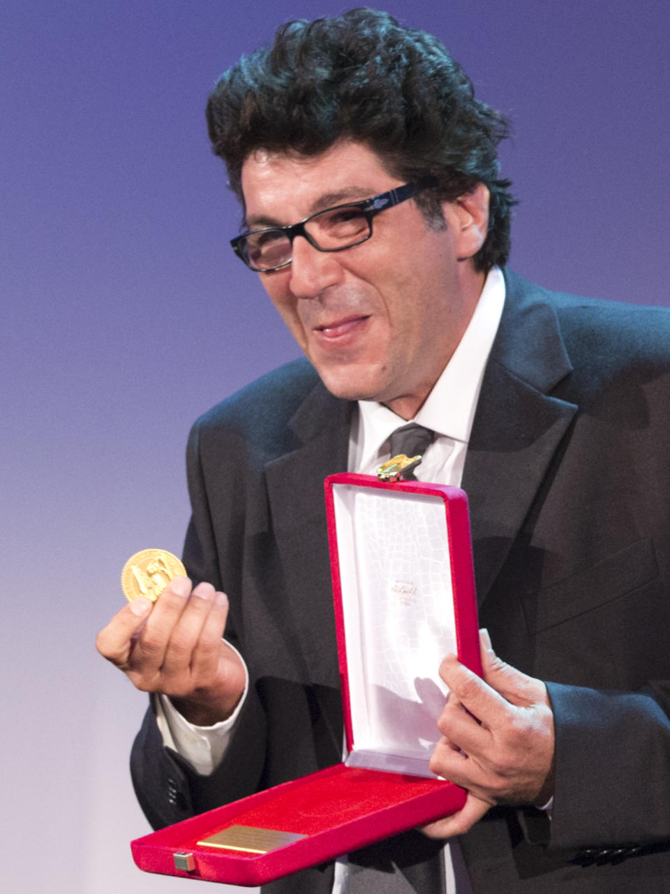 Director Daniele Cipri' shows his prize for Best Photography for his movie 'E' Stato Il Figlio' at the 69th edition of the Venice Film Festival in Venice, Italy, Saturday, Sept. 8, 2012. (AP Photo/Domenico Stinellis)