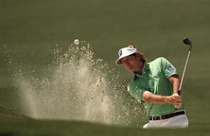 Brandt Snedeker of the U.S. hits from a sand trap on the second hole during third round play in the 2013 Masters golf tournament in Augusta