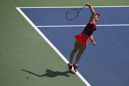Halep of Romania serves the ball to Erakovic of New Zealand in their first round match at the U.S. Open Championships tennis tournament in New York