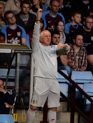 Ronnie Moore has urged Tranmere to not get caught up in Bournemouth&#39;s welcome party