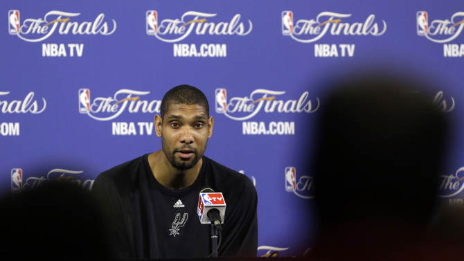 San Antonio Spurs power forward Tim Duncan speaks to members of the media during a news conference after NBA basketball practice, Wednesday, June 19, 2013, at the American Airlines Arena in Miami. The Spurs take on the Miami Heat in Game 7 of the NBA Finals on Thursday in Miami. (AP Photo/Wilfredo Lee)