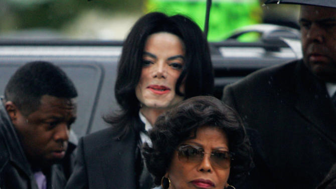 FILE - In this Monday, Feb. 28, 2005 file photo, Michael Jackson follows his mother, Katherine Jackson, as they arrive for court on the opening day of his child molestation trial at Santa Barbara County Superior Court in Santa Maria, Calif. Katherine Jackson is pursuing a lawsuit against AEG Live, the promoters of her son's planned comeback concerts, with opening statements in the case scheduled to begin on Monday, April 29, 2013. AEG denies any wrongdoing. (AP Photo/Marcio Jose Sanchez, File)
