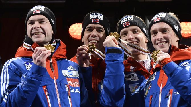 Norway's team members pose with their gold medals after their men's large hill team ski jumping final at the FIS Nordic Skiing World Championships in central Falun