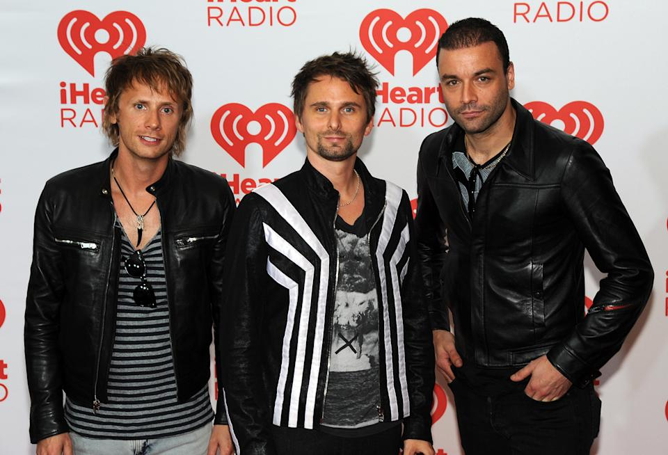 "In this photo provided by the Las Vegas News Bureau, English rock band ""Muse"" walk the red carpet at the MGM Grand Hotel during the iHeartRadio Music Festival in Las Vegas Friday, Sept. 20, 2013. (AP Photo/Las Vegas News Bureau, Brian Jones)"