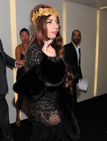 "Singer Lady Gaga arrives at a ""Lady Gaga Fame"" fragrance launch event at the Guggenheim Museum on Thursday, Sept. 13, 2012 in New York. The black tie masquerade event will feature a performance art piece by Lady Gaga, ""Sleeping with Gaga."" The film for ""Lady Gaga Fame"", directed by Steven Klein, will also be unveiled during the evening. (Photo by Evan Agostini/Invision/AP)"