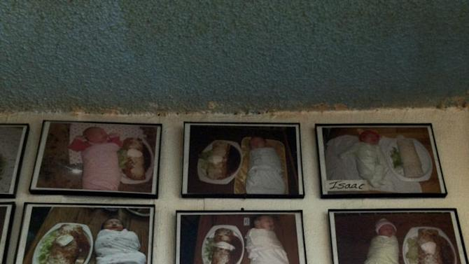The baby photo wall as captured by one Reddit user.
