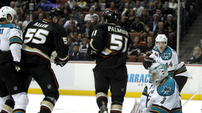 San Jose Sharks goalie Thomas Greiss (1), of Germany, stops a shot on goal with Anaheim Ducks defenseman Bryan Allen (55) and Anaheim Ducks right wing Kyle Palmieri (51) on the attack with Sharks defenseman Brad Stuart, left, and Sharks defenseman Marc-Edouard Vlasic (44) defending during the second period of their NHL hockey game, Monday, Feb. 4, 2013, in Anaheim, Calif.  (AP Photo/Alex Gallardo)