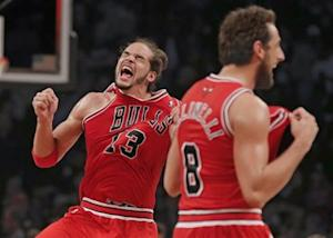 Chicago Bulls center Noah and Chicago Bulls guard Belinelli celebrate after they beat Brooklyn Nets to advance to next round in Game 7 of their NBA Eastern Conference Quarterfinals basketball playoff series in New York