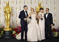 "Daniel Day Lewis, Best Actor for ""Lincoln,"" Jennifer Lawrence, Best Actress for ""Silver Linings Playbook,"" Anne Hathaway, Best Supporting Actress for ""Les Miserables"" and Christoph Waltz (L-R), Best Supporting Actor for ""Django Unchained,"" pose with their Oscars backstage at the 85th Academy Awards in Hollywood, California February 24, 2013. REUTERS/Mike Blake"