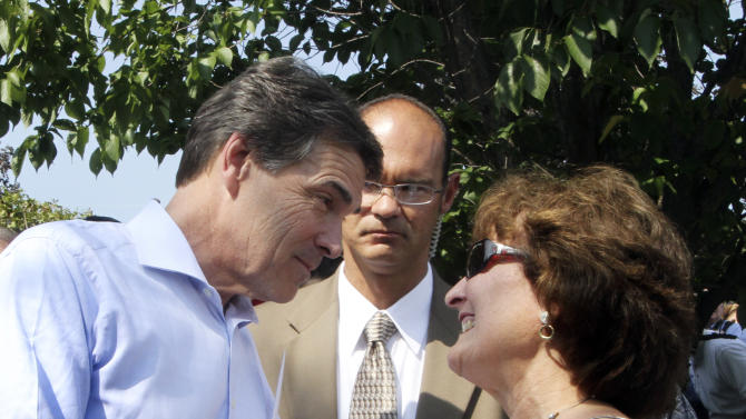 Republican presidential candidate, Texas Gov. Rick Perry, meets guests at a house party, Saturday, Sept. 3, 2011 in Manchester, N.H. (AP Photo/Jim Cole)