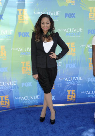 "FILE - In this Aug. 7, 2011 photo, Raven-Symone arrives at the Teen Choice Awards in Universal City, Calif. Raven-Symone is all grown up, and going to a convent. The former ""The Cosby Show"" actress will take over the lead part in Broadway's hit musical ""Sister Act"" later this month, playing a nightclub-singer-turned-nun. (AP Photo/Dan Steinberg)"