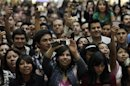 """Fans take pictures of singer Perry with their mobile phones during an autograph-signing event as part of promotional activities for her new fragrance """"Purr"""" in Mexico City"""