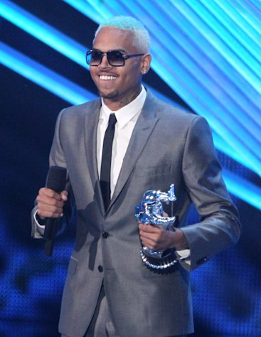 "Chris Brown accepts the award for best male video for ""Turn Up the Music"" at the MTV Video Music Awards on Thursday, Sept. 6, 2012, in Los Angeles. (Photo by Matt Sayles/Invision/AP)"