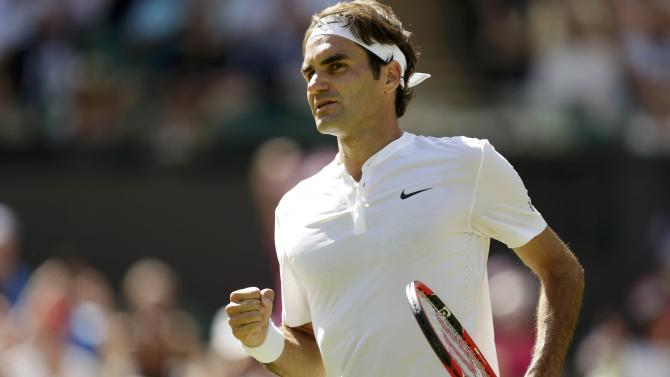 Roger Federer of Switzerland celebrates after winning his match against Samuel Groth of Australia at the Wimbledon Tennis Championships in London