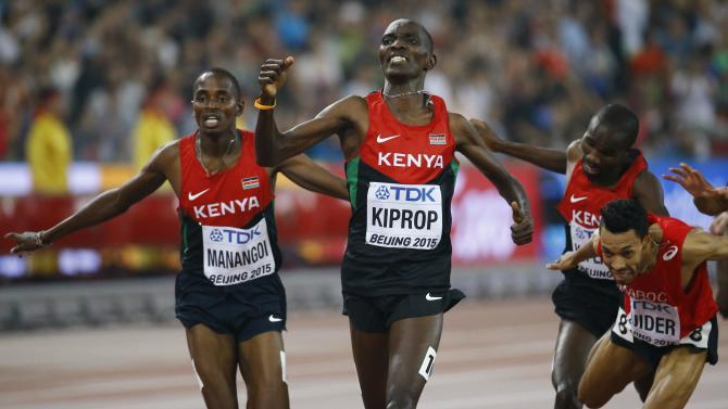 Kiprop gestures after winning the men's 1500 metres final at the 15th IAAF Championships at the National Stadium in Beijing