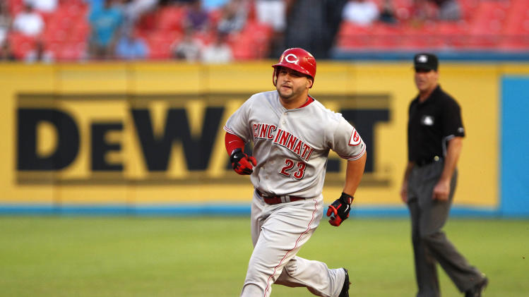 Cincinnati Reds' Yonder Alonso rounds second base after hitting a home run during the second inning of a baseball game against the Florida Marlins, Tuesday, Aug. 23, 2011, in Miami. (AP Photo/Wilfredo Lee)