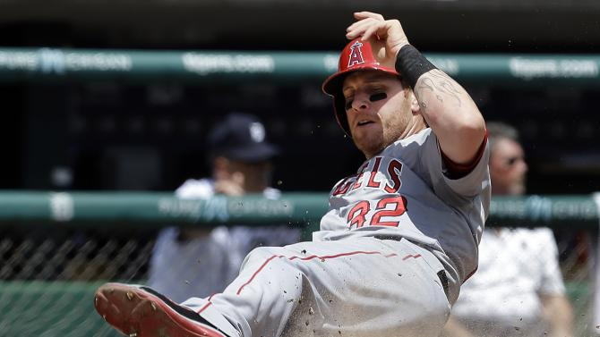 Los Angeles Angels' Josh Hamilton scores on a Brad Hawpe single against the Detroit Tigers in the fourth inning of a baseball game in Detroit, Thursday, June 27, 2013. The (AP Photo/Paul Sancya)