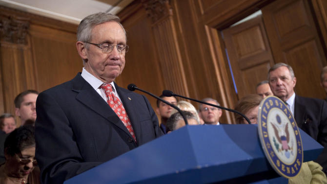 Senate Majority Leader Sen. Harry Reid, D-Nev., pauses during a news conference on debt ceiling legislation on Capitol Hill on Saturday, July 30, 2011, in Washington. The Republican-led House on Saturday rejected a Senate Democratic bill to raise the nation's debt limit just three days before the deadline to avert an unprecedented U.S. financial default. (AP Photo/Evan Vucci)