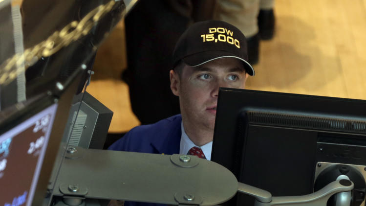 "Specialist Frank Masiello wears a ""Dow 15,000"" hat as he works at his post on the floor of the New York Stock Exchange Friday, May 3, 2013. A big gain in the job market is lifting the stock market to a record high. The Dow Jones industrial average crossed 15,000 for the first time, and the Standard and Poor's 500 index, a broader market measure, rose above 1,600.(AP Photo/Richard Drew)"