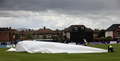 Groundstaff put on the covers as rain stops play for a period during the Ireland verses Pakistan  One Day Cricket  International at Clontarf Cricket Club, Dublin, Ireland, Thursday, May 23, 2013