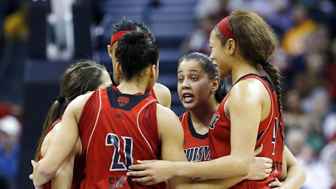 Louisville guard Shoni Schimmel (23) talks with her teammates during a timeout in the second half of a regional semifinal game against Baylor in the women's NCAA college basketball tournament in Oklahoma City, Sunday, March 31, 2013. Louisville won 82-81. (AP Photo/Sue Ogrocki)