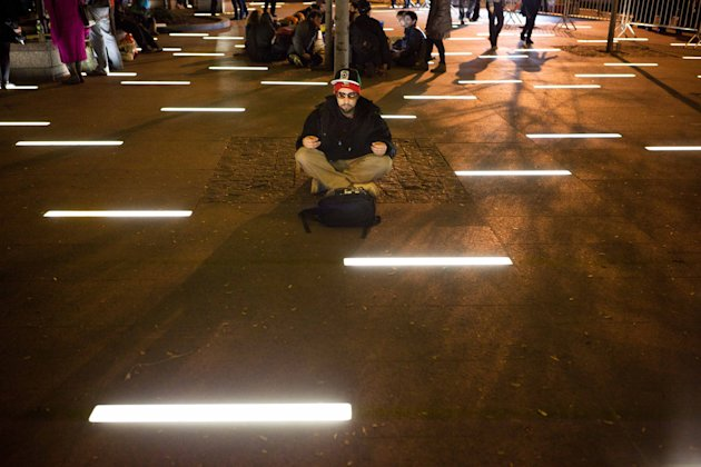 An Occupy Wall Street protestor meditates in a newly tent-free Zuccotti Park during the early morning hours, Wednesday, Nov. 16, 2011, in New York. Crackdowns against the Occupy Wall Street encampment