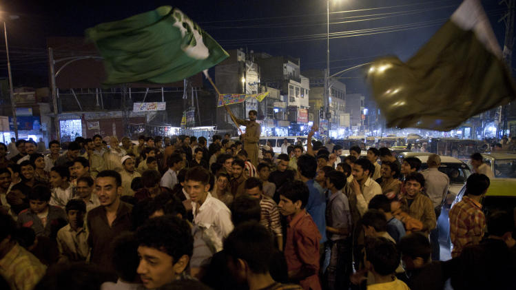 Pakistani cricket fans celebrate the victory of Pakistani team against West Indies in the quarterfinal of the cricket World Cup, in Rawalpindi, Pakistan on Wednesday March 23, 2011. (AP Photo/B.K.Bangash)