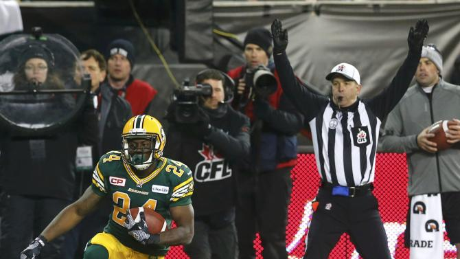Edmonton Eskimos' Akeem Shavers reacts after scoring a touchdown in the second quarter during the CFL's 103rd Grey Cup championship football game against the Ottawa Redblacks in Winnipeg