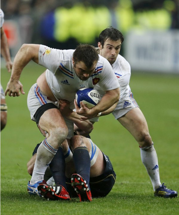 France's Nicolas Mas fights for the ball during their Six Nations rugby union match against Scotland at the Stade de France in Saint-Denis