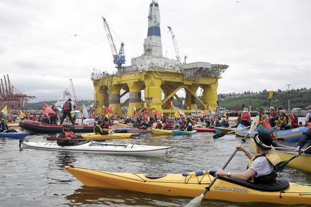 Activists protest the Shell Oil Company's drilling rig Polar Pioneer which is parked at Terminal 5 at the Port of Seattle, Washington