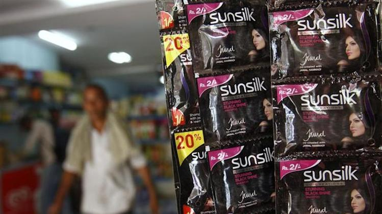 Sachets of shampoo by Sunsilk, a Hindustan Unilever Limited (HUL) brand, hang on display at a shop in the old quarters of Delhi May 13, 2013. REUTERS/Mansi Thapliyal/Files