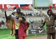 Men's 800m world record holder, David Rudisha (L) of Kenya celebrates after winning a race during the London Olympics 2012 trials at Nyayo stadium, in the Kenyan capital, Nairobi