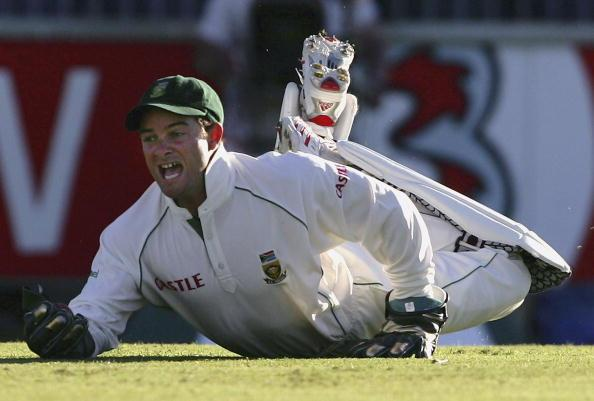 PERTH, AUSTRALIA - DECEMBER 17:  Mark Boucher of South Africa dives to catch Matthew Hayden of Australia during day two of the First Test between Australia and South Africa played at the WACA on Decem