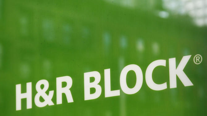 This March 5, 2012 photo shows a sign for H&R Block at an office, in New York. H&R Block said Tuesday, June 26, 2012, its fiscal fourth-quarter profit declined 11 percent from a year ago on slightly lower revenue and costs from restructuring. (AP Photo/Mark Lennihan)