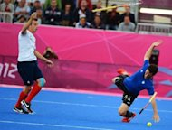 Great Britain's Matt Daly (L) vies for the ball with Argentina's Pedro Ibarra (R) during their London 2012 Olympic men's field hockey match at the Riverbank arena in the Olympic park, London. Britain won 4-1