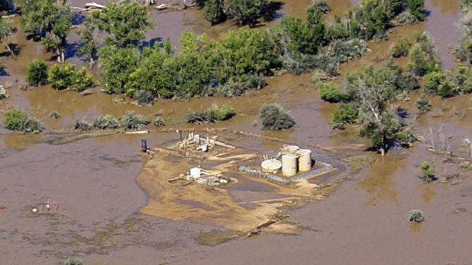 This Sept. 17, 2013 photo provided by Ecoflight shows the result of flash floods that swamped well pads and in some cases dislodged storage tanks in Weld County, Colo. Hundreds of natural gas and oil wells along with pipelines are shut down by flooding, as state and federal inspectors are gauging the damage and looking for contamination from inundated oil fields. (AP Photo/Ecoflight, Jane Pargiter)