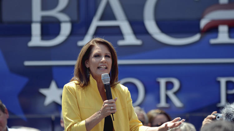 Republican presidential candidate, Rep. Michele Bachmann, R-Minn., speaks to supporters at the Beacon Drive-in, Tuesday, August 16, 2011, in Spartanburg, S.C. (AP Photo/ Richard Shiro)