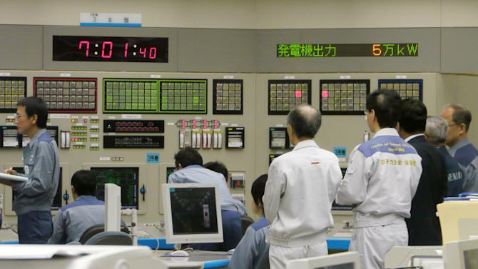Technicians monitor at central control room of Ohi nuclear power plant in Ohi town, Fukui prefecture, western Japan after the No. 3 reactor began generating electricity in the first restart since last year's tsunami led to a nationwide nuclear power plant shutdown Thursday, July 5, 2012. (AP Photo/Kyodo News) JAPAN OUT, MANDATORY CREDIT, NO LICENSING IN CHINA, HONG KONG, JAPAN, SOUTH KOREA AND FRANCE