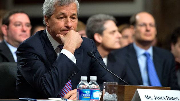 JP Morgan CEO's Pay Cut After Loss (ABC News)