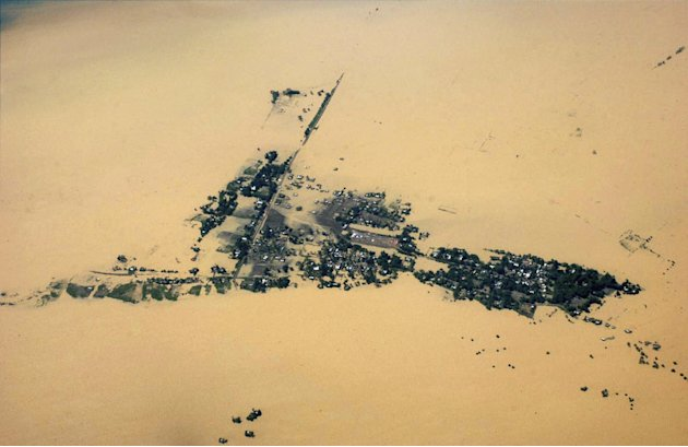 This aerial photo shows a flooded area of Jorhat in Assam state, India, Monday, July 2, 2012. The floods from monsoon rains in northeastern India killed dozens of people, with more than 2,000 villages
