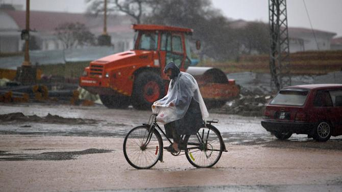 A Pakistani cyclist rides on a road during the rain in Islamabad, Pakistan, Monday, March 2, 2015. (AP Photo/Anjum Naveed)