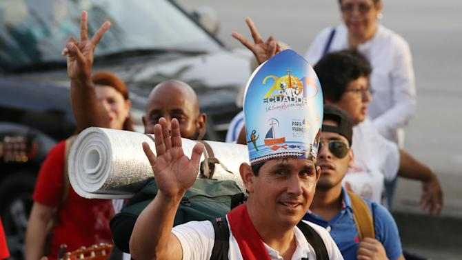 Pilgrims walk towards Samanes Park to take part in a vigil in Guayaquil, Ecuador, Sunday, July 5, 2015. Pope Francis is making his first visit as pope to his Spanish-speaking neighborhood. He'll travel to three South American nations, Ecuador, Bolivia and Paraguay, which are beset by problems that concern him deeply, income inequality and environmental degradation. (AP Photo/Fernando Vergara)