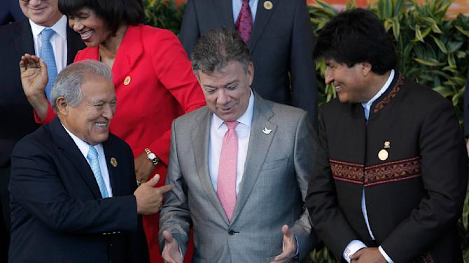 El Salvador's President Ceren, Colombia's President Santos and Bolivia's President Morales chat during a family photo at the CELAC summit in San Antonio de Belen