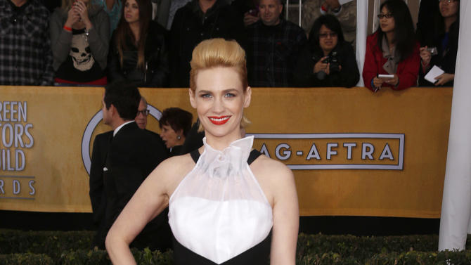 January Jones arrives at the 19th Annual Screen Actors Guild Awards at the Shrine Auditorium in Los Angeles on Sunday Jan. 27, 2013. (Photo by Todd Williamson/Invision for The Hollywood Reporter/AP Images)