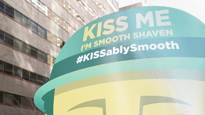 """IMAGE DISTRIBUTED FOR GILLETTE - Football star Brian Westbrook shaved his signature goatee to declare """"Kiss Me, I'm Smooth Shaven!"""" onboard the Gillette float at the St. Patrick's Day Parade in Philadelphia, reminding guys to K.I.S.S.--Keep It Smooth Shaven-- on Sunday, March 30, 2013. A recent study revealed that 85% of women prefer to kiss a man who is smooth shaven, and that two out of three women said men will have better luck with them if they are stubble-free. (Photo by Mark Stehle/Invision for Gillette/AP Images)"""