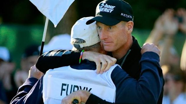 "Jim Furyk (R) celebrates with his caddie Mike ""Fluff"" Cowan after putting on the ninth green to shoot a 59 during the second round of the BMW Championship (AFP)"