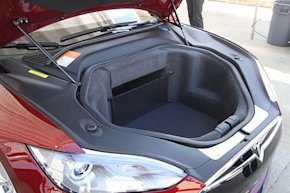 The front hood opens to reveal a generous cargo area.